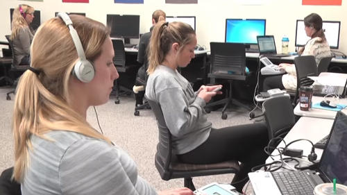 Students practicing in an audio lab
