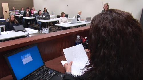 Court reporting teacher dictating in the classroom