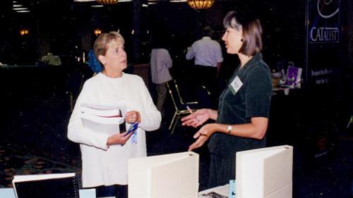 Author Marlene Struss explains StarTran to a court reporting teacher at the Teacher's Workshop